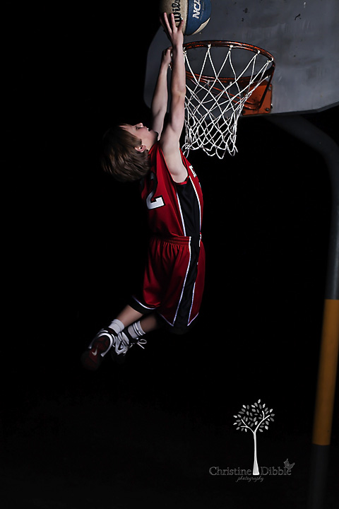 Brennen dunks the basketball.