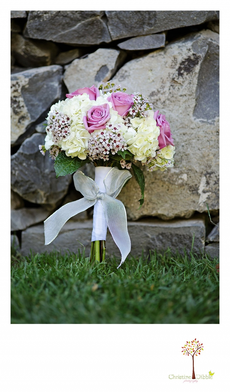Christine Dibble Photography, Sonora and Reno wedding photographer, photographs a wedding bouquet.