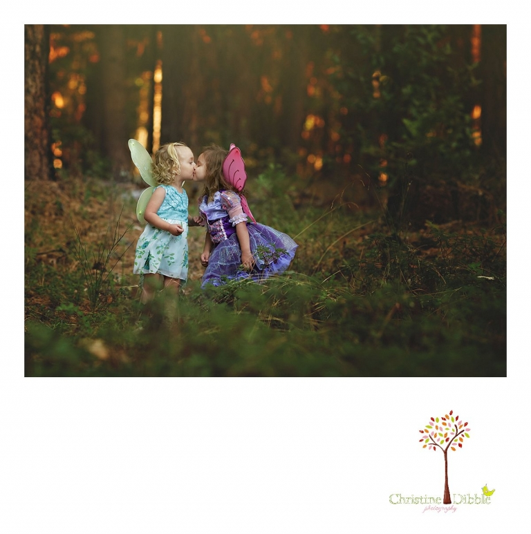 Sonora photography by Christine Dibble Photography captures photos of two little forest fairies kissing during Grass Valley mini sessions at Empire Mine State Park.