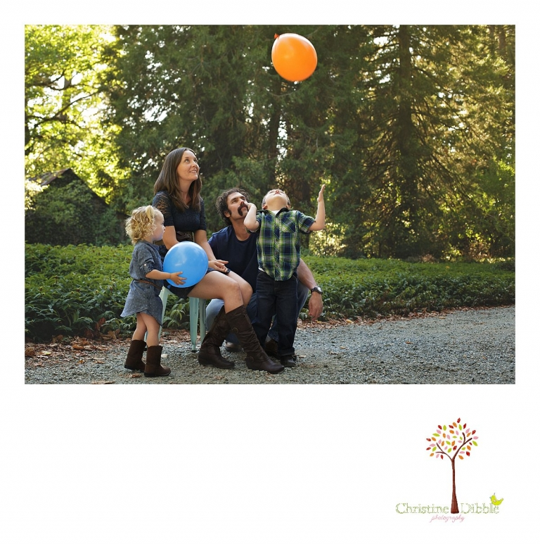 Sonora photography by Christine Dibble Photography captures photos of a family playing with a balloon during mini sessions at Empire Mine State Park in Grass Valley.