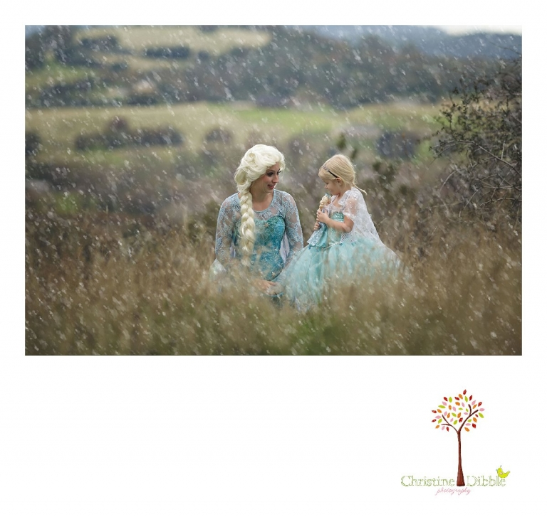 Sonora Elsa photographer Christine Dibble Photography photographs the beautiful princess Elsa and her biggest fan, a three year old girl dressed in an Elsa tutu as they sit under falling snow.
