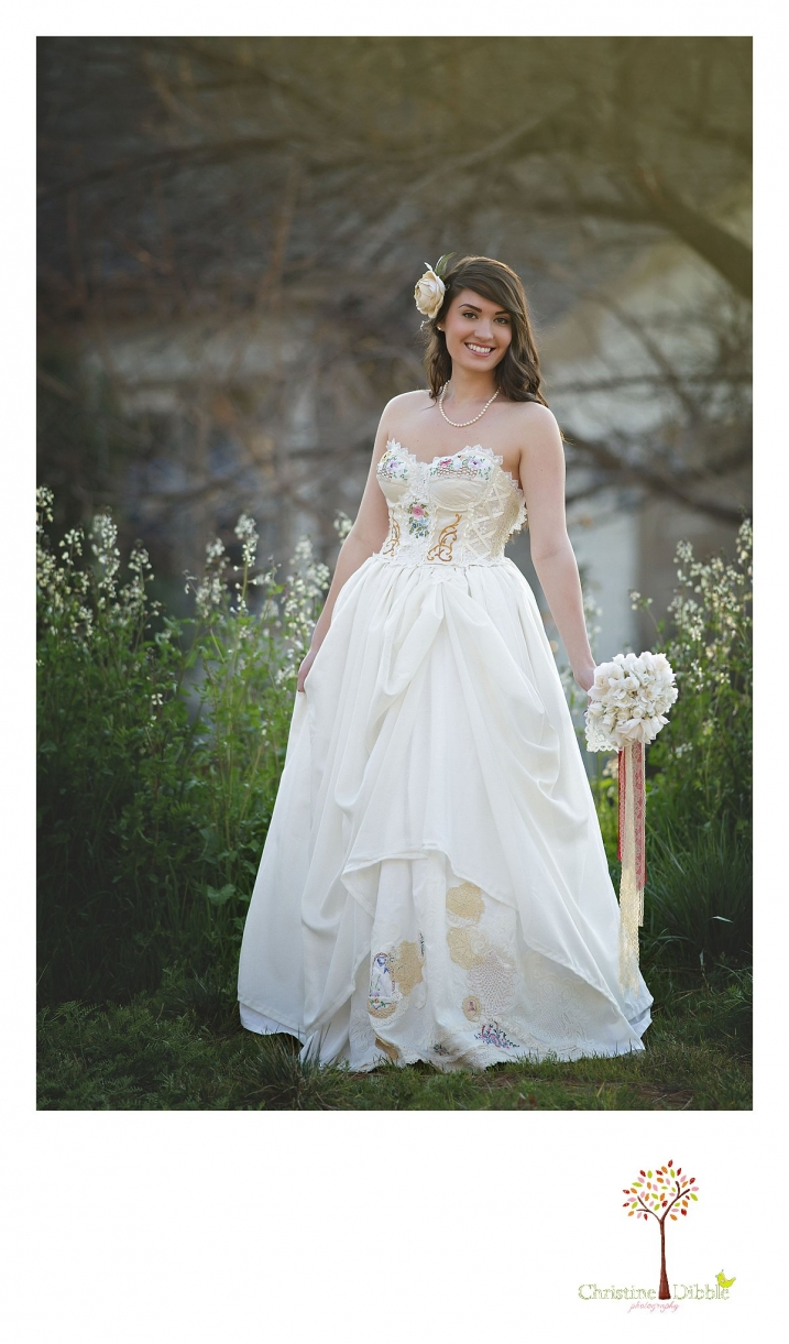 Sonora wedding photographer Christine Dibble Photography takes outdoor sunset photos of a model wearing a dress crafted of vintage linens and a hair flower by Hopefully Romantic near Twain Harte.