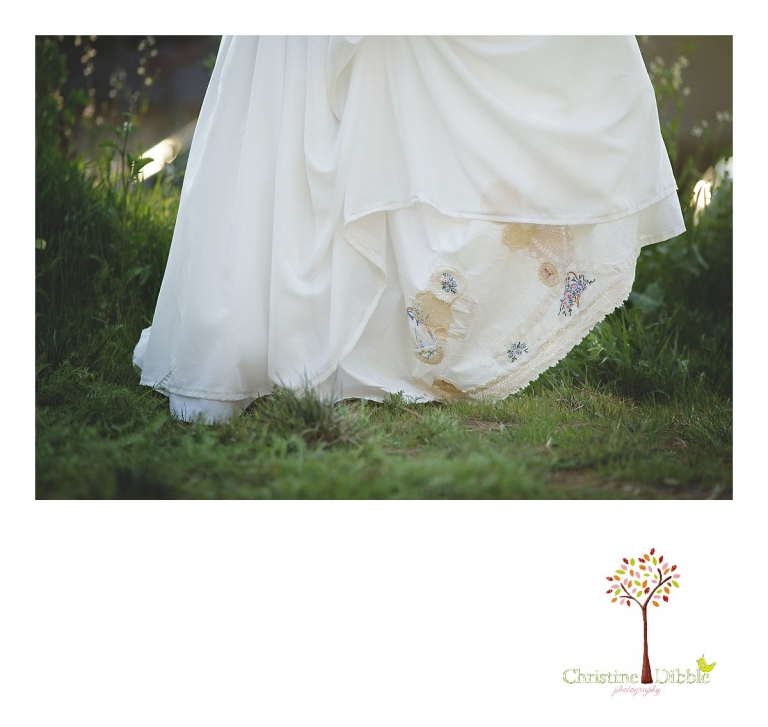 Sonora wedding photographer Christine Dibble Photography takes outdoor sunset photos of the skirt of a dress crafted of vintage linens and a hair flower by Hopefully Romantic near Twain Harte.