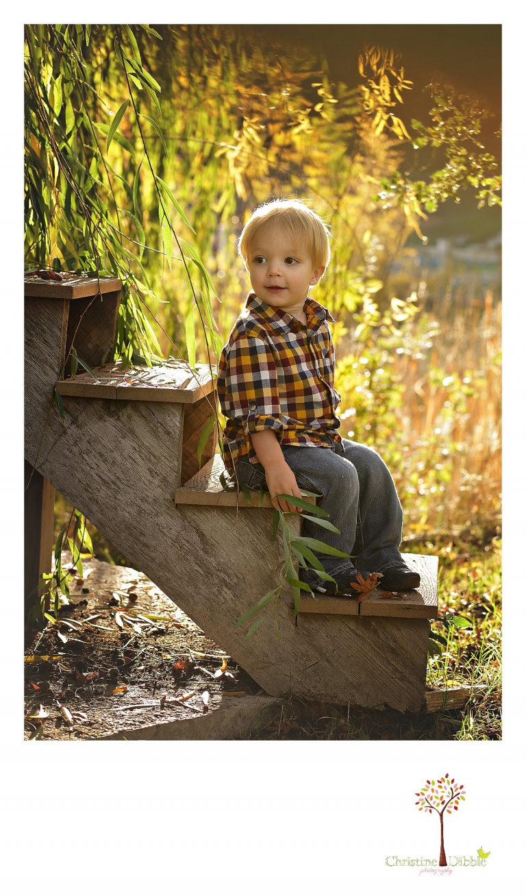 Best Sonora family photographer Christine Dibble Photography takes sunset photos of a toddler sitting on stairs to a water tank.