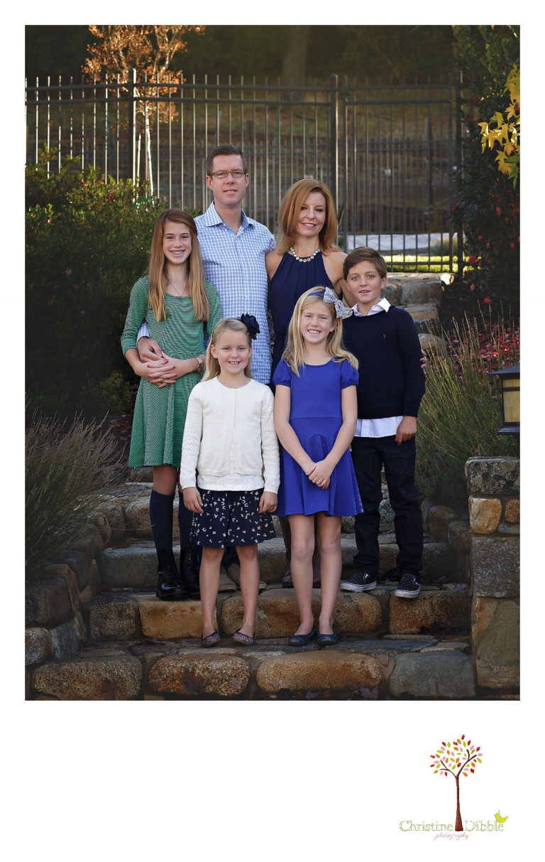 Christine Dibble Photography, best Sonora family photographer, takes outdoor portraits of a blended family in their renovated backyard in Tuolumne.