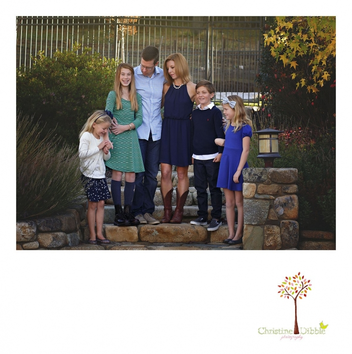 Christine Dibble Photography, best Sonora family photographer, takes outdoor portraits of a blended family on the stone steps in their renovated backyard in Tuolumne.