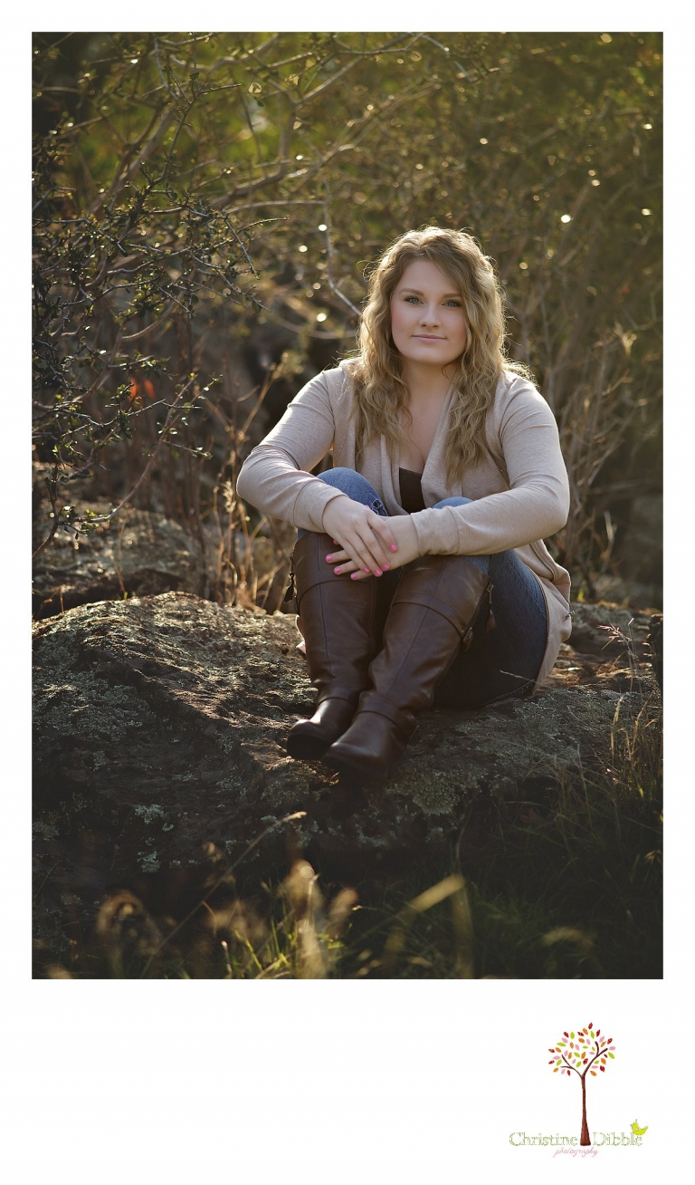 Sonora and Summerville High School senior portrait photographer Christine Dibble Photography takes outdoor photos of a beautiful senior girl sitting on a granite rock.