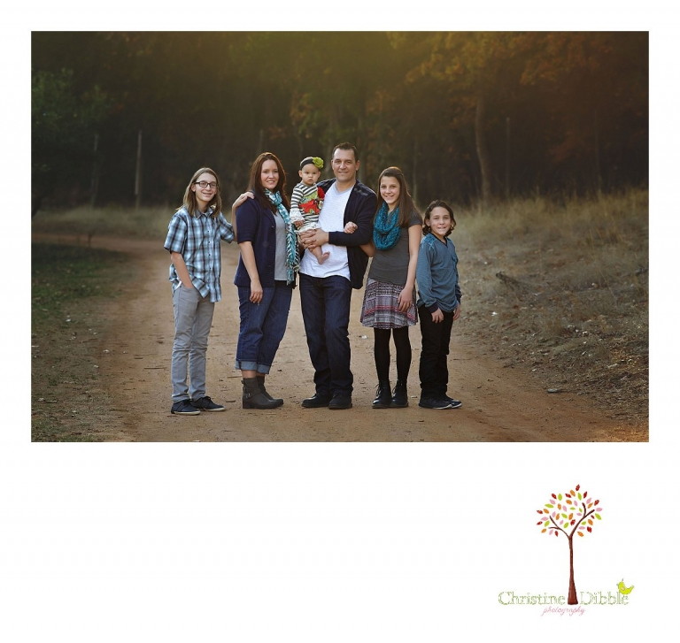 Indigeny Reserve photographer Christine Dibble Photography of Sonora takes family photos of a family with four children on a dirt road with fall color behind them.