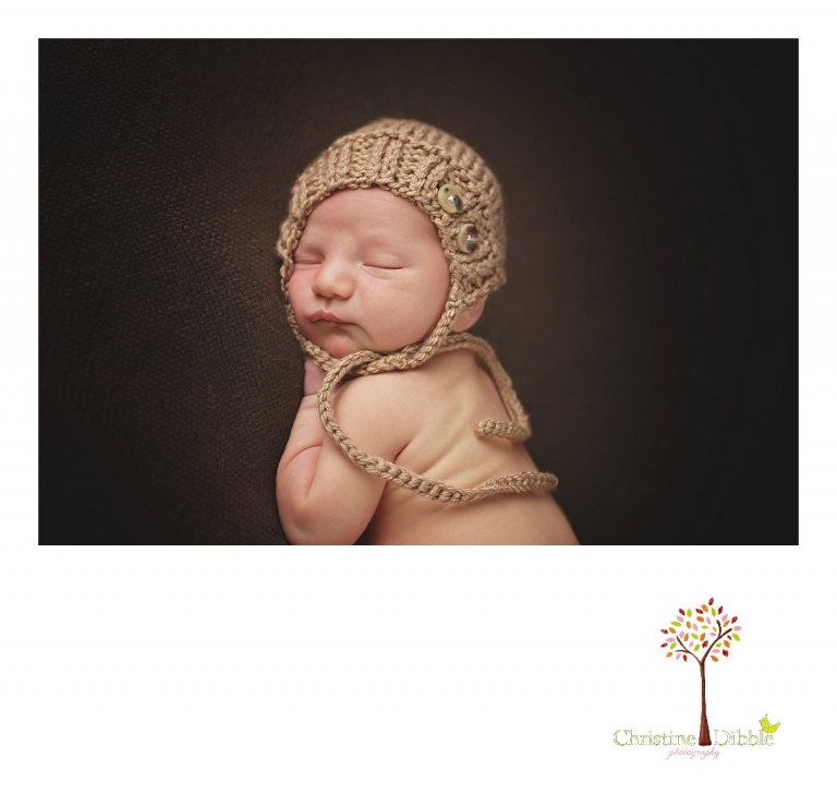 Sonora newborn photography session by Christine Dibble Photography captures a sleeping baby boy in a tan bonnet from the Primrose Bunny on ETSY.