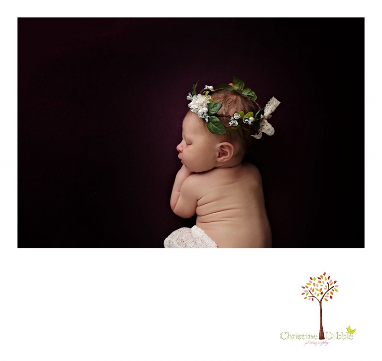 Best Sonora newborn photographer Christine Dibble Photography takes indoor studio photos of a newborn baby girl wearing a Hopefully Romantic head wreath as she sleeps on a blanket.