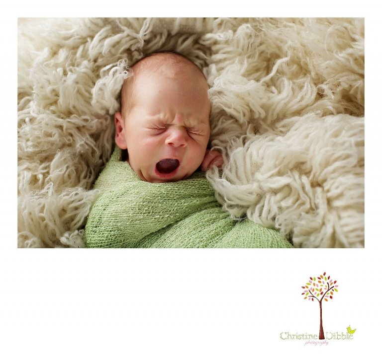 Best Sonora newborn photographer Christine Dibble Photography takes photos of a nine day old baby boy as he yawns.