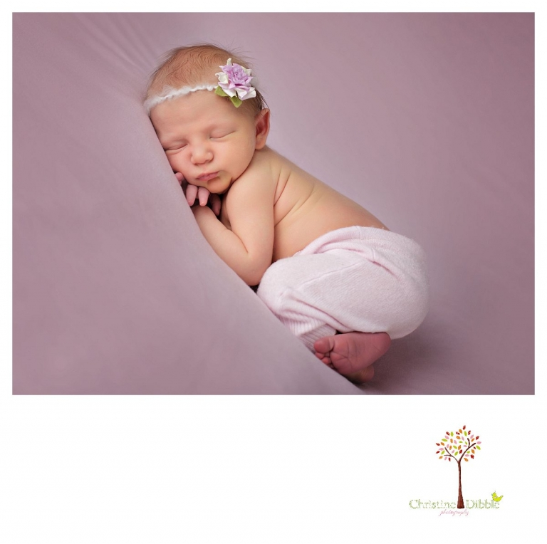 Sonora newborn photographer Christine Dibble Photography takes photos of a baby girl in a flowered headband.