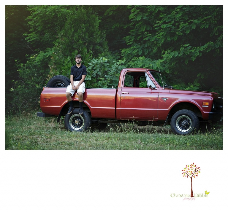 Sonora and Summerville senior portrait photographer Christine Dibble Photography takes senior portraits of a boy at Twain Harte Tree Farm with his red Chevy truck.