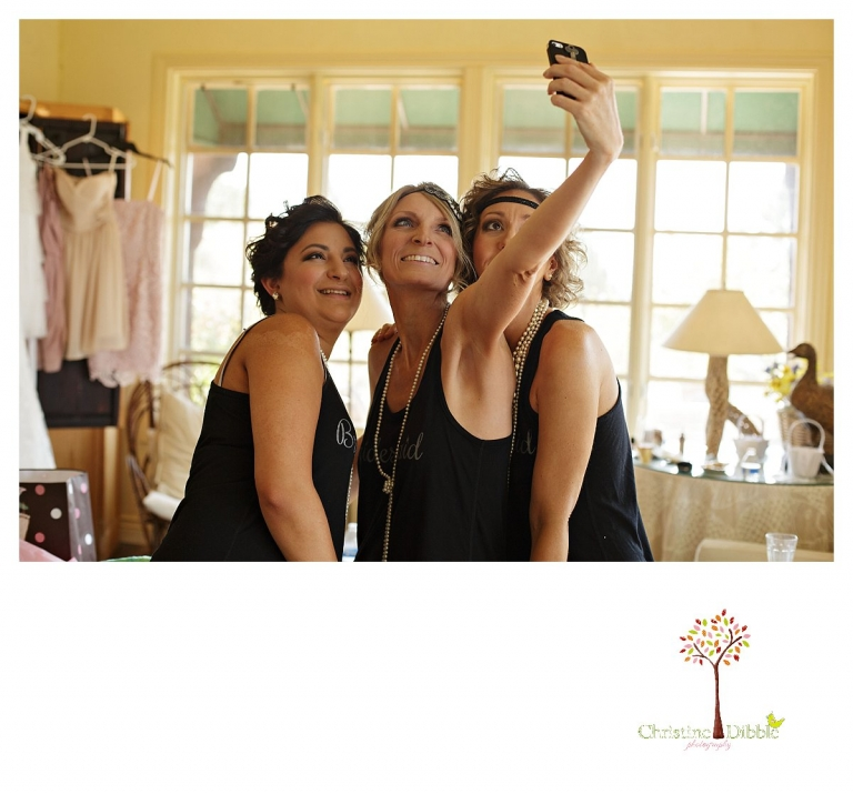 Sonora wedding photographer Christine Dibble Photographer captures a Venticello wedding in Murphys and bridesmaids taking selfies.