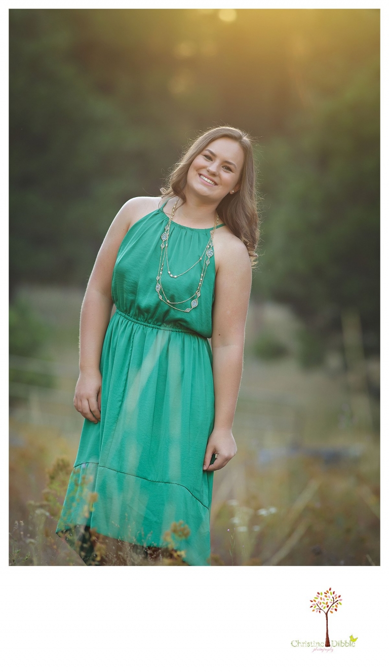 Senior portraits in Sonora taken of a Summerville Class of 2016 senior by Christine Dibble Photography as the senior girl stands in golden hour sunlight.