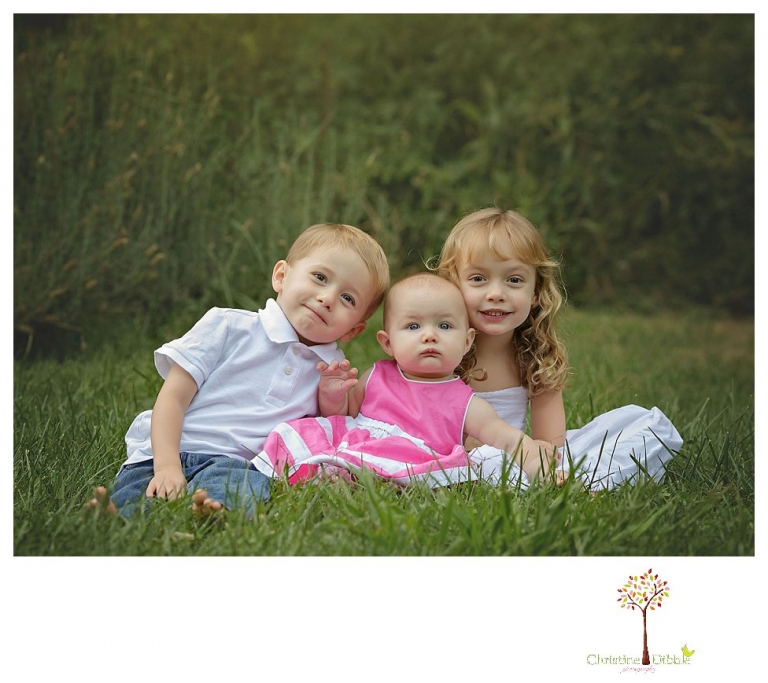 Sonora family photographer Christine Dibble Photography takes photos of three young children at a family portrait session at Twain Harte Tree Farm.