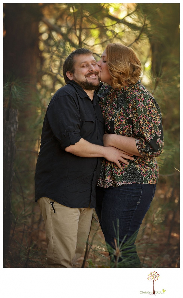 Sonora engagement and couple's portrait photographer Christine Dibble Photography takes photos of couples laughing, kissing, cuddling and having fun outdoors in golden sunlight.