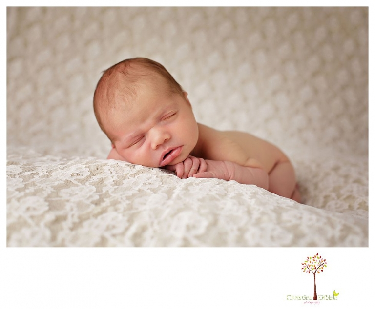 Best Sonora Newborn Photographer Christine Dibble Photography takes portraits of a sleeping newborn on blankets, in wraps and props, and on her mother's wedding dress.