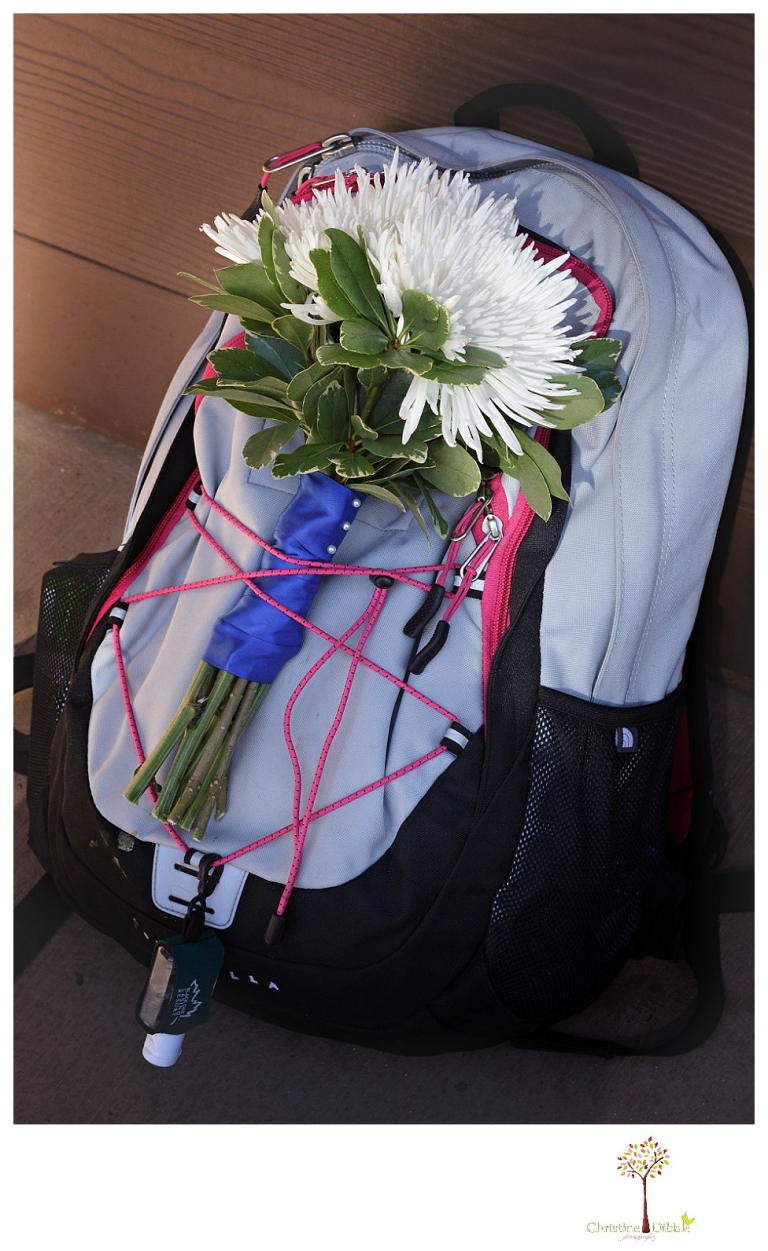 Sonora and Pinecrest wedding photographer Christine Dibble Photography takes wedding photos at a Pinecrest elopement including the bride's backpack and bouquet sitting by the trail before she hiked down the aisle.