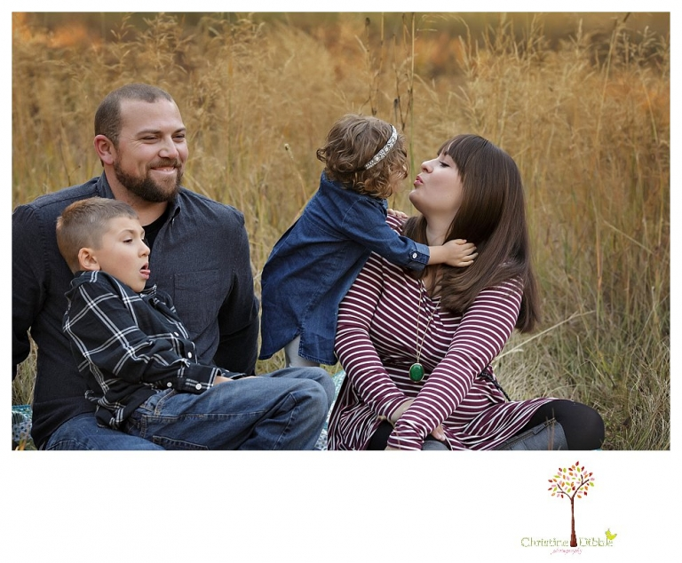 Sonora family photographer Christine Dibble Photography takes family portraits at Pinecrest Lake as the family plays in a field and then wears ugly sweaters for Christmas card photos.
