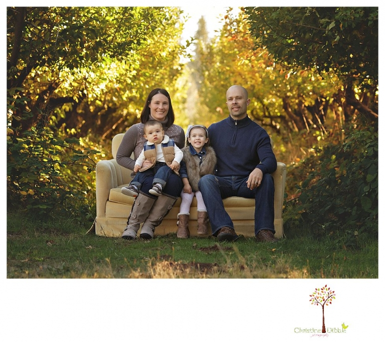 Sonora Family Photographer Christine Dibble Photography takes extended Fall family photos at Indigeny Reserve on a cream velvet loveseat sitting in the apple orchard.