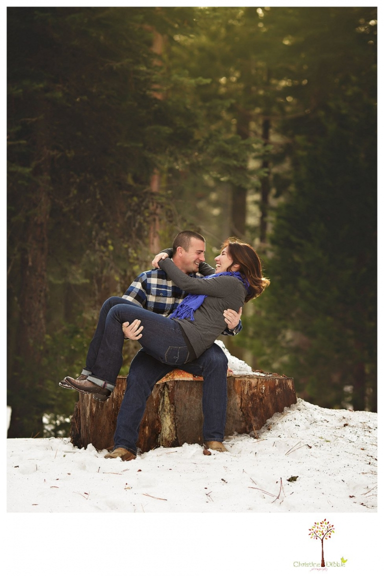 Sonora Engagement Photographer Christine Dibble Photography takes engagement photos in the snow on Valentine's Day at Pinecrest Lake as a couple laughs and throws snowballs for beautiful engagement portraits.