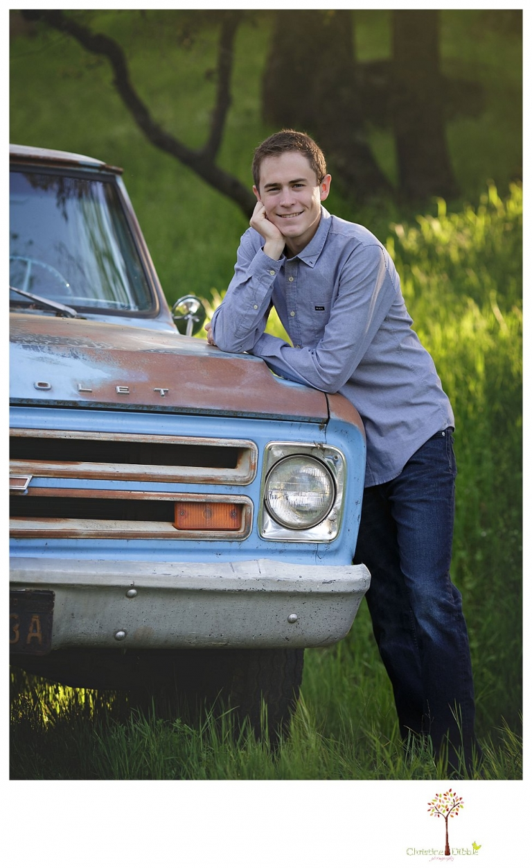 Sonora High senior portrait photographer Christine Dibble Photography takes outdoor spring senior portraits of a track star in his yard with his letterman jacket and old Chevy truck.
