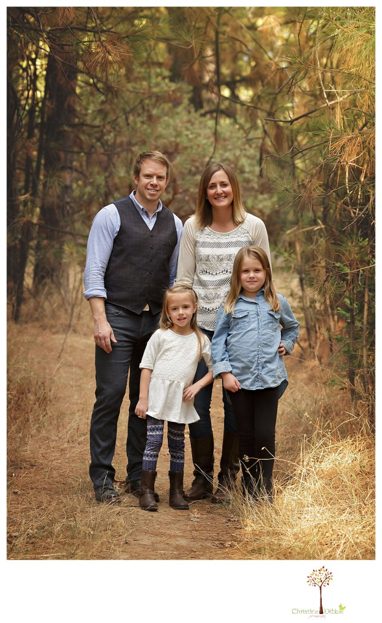 Sonora Family Photographer Christine Dibble Photography takes fall family portraits of a family with two little girls in both formal poses and while they hunt for ladybugs.
