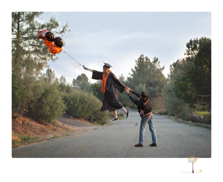 Sonora senior portrait photographer Christine Dibble Photography takes a levitation photo of a Summerville High School graduate floating away as her junior boyfriend tries to keep her from flying off.