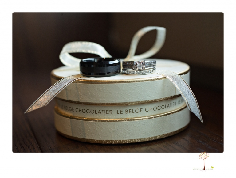 Sonora Wedding Photographer Christine Dibble Photography takes wedding photos at a Black Oak Casino Resort wedding including macro shots of the rings on a chocolate box.