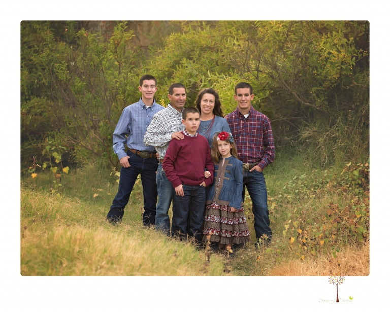 Sonora family photographer Christine Dibble Photography takes family portraits at Knights Ferry of a large family in perfectly coordinating outfits.