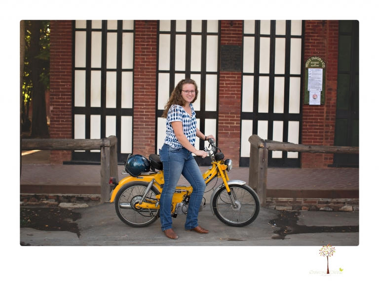 Sonora and Summerville High senior portrait photographer Christine Dibble Photography takes senior portraits of a Summerville High senior girl in Columbia State Historic Park with her moped and Edelweiss necklace.