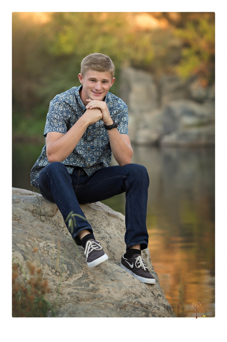 Summerville High senior portrait photographer Christine Dibble Photography of Sonora takes senior portraits of a wrestler at Knights Ferry with his wake board in the river, his jeep and letterman jacket.