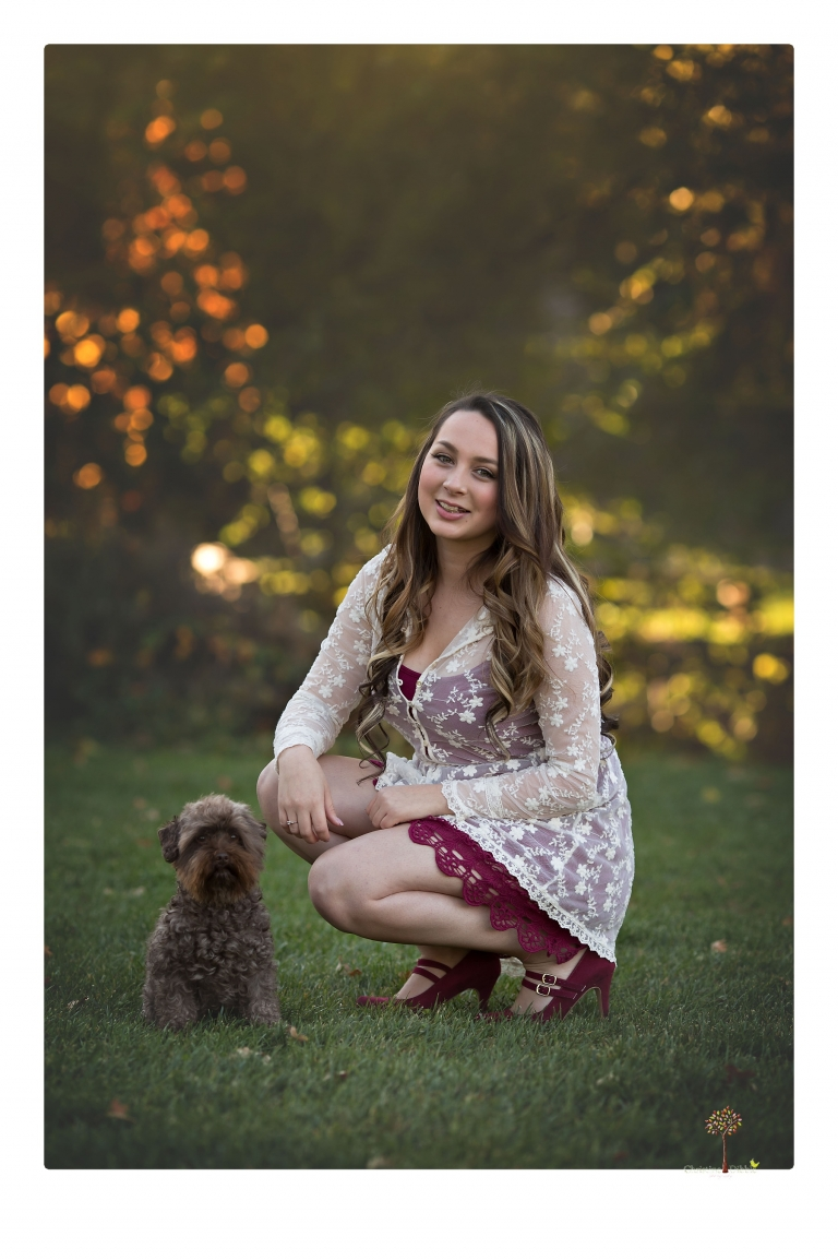 Sonora and Summerville Senior Portrait photographer Christine Dibble Photography takes senior portraits at Indigeny Reserve of a girl with vintage suitcases, a classic Ford Mustang, and her little dog, Pumpkin.