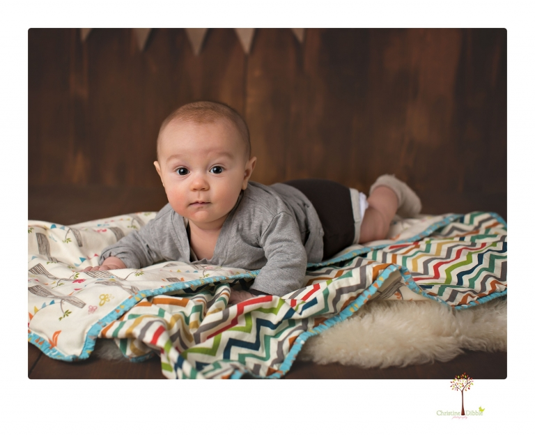 Sonora baby and child photographer Christine Dibble Photography takes three month portraits of a baby boy and his parents in the studio.