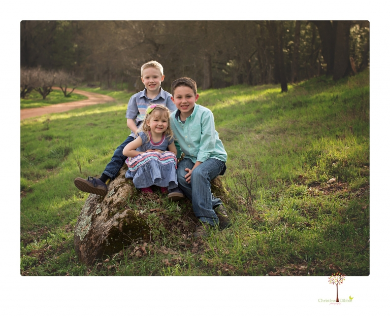 This Indigeny family portrait session, photographed by Christine Dibble Photography of Sonora, included lots of play and group hugs and running around for natural and relaxed family portraits.