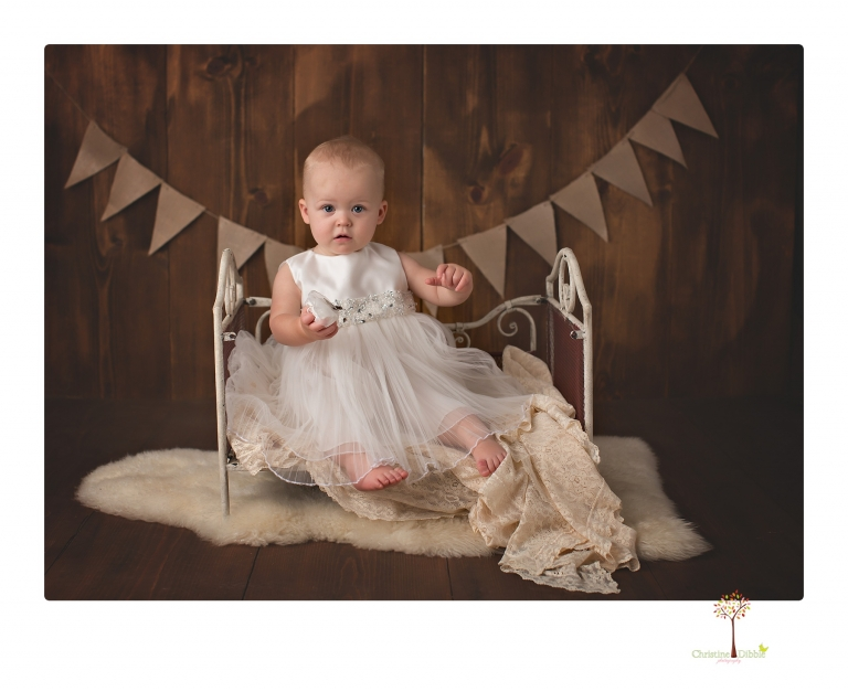 Sonora Baby Photographer Christine Dibble Photography photographs a first birthday session of a girl wearing a flower girl dress made from her mother's wedding dress.