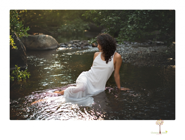 Sonora photographer Christine Dibble Photography takes portraits of a senior in Mammoth Lakes as she poses in a creek and meadow in thrift shop dresses.